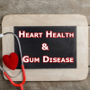 Heart Health and Gum Disease on Chalk Board with stethoscope and heart