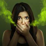 Woman with halitosis