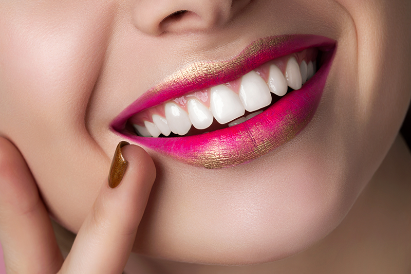 Woman smiling after a dental spa day