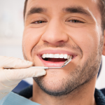 Young man at dentist - diseases your dentist can detect