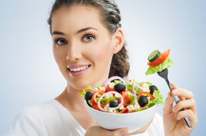 Woman eating healthy with a brilliant smile
