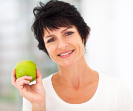 Woman with healthy smile holding an apple